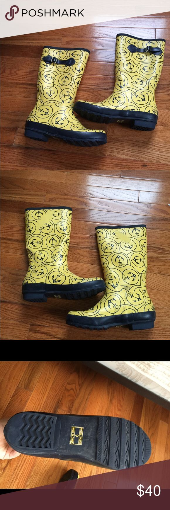 LL Bean Yellow and Navy Nautical Rainboots LL Bean Yellow and Navy Nautical Rainboots. Small part with pattern worn off on inside. Good treads. Lifetime guarantee from LL Bean! L.L. Bean Shoes Winter & Rain Boots