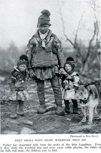 Lapp, Saami, 1939   National Geographic photograph by Borg Mesch  They shall have music wherever they go.  Father has suspended bells from the necks of the little Lapplings.  Even if they elude the watchful dog and stray away while paying the tinkle of the bells will make the children easy to find