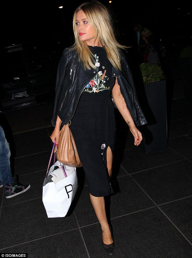 Leading the charge: Laura Whitmore opted for a more demure look as she arrived back at her...