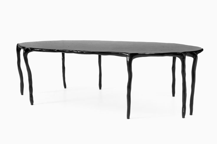 The Clay Dining Table is part of Maarten Baas's Clay Furniture collection.