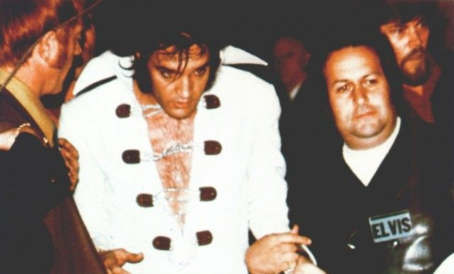 Elvis and Joe Esposito during the first tour of the 70s.  Red West can be seen to the left and Sonny West in the background, right.