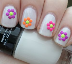 Fun 60's hippie vibe nails using the Make Up Gallery Winter White nail polish and circle studs from our nail art decoration set.