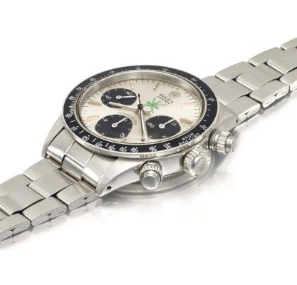 Rolex. An exceptionally rare stainless steel chronograph wristwatch with green « Khanjar » symbol, presented by the Sultan of Oman to the current owner in 1974, sold with the original sales tag, box, period blank guarantee and brochures ROLEX, OYSTER COSMOGRAPH, DAYTONA MODEL, REF. 6263, CASE NO. 3'048'293, CIRCA 1972 Price realised CHF 727,500 Estimate CHF 320,000 - CHF 420,000