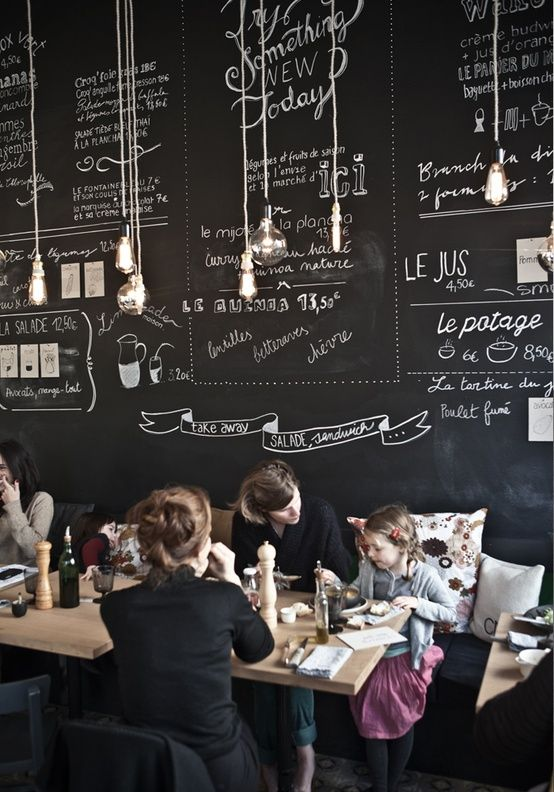 love the blackboard for a wall idea. menus etc can be refreshed. Also love long bench along the back wall and small tables for 2 that can be pushed together and leave just gaps every other table to move past to sit on the bench