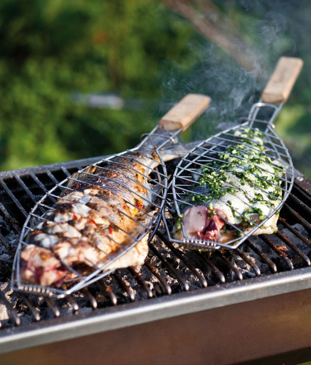 The sea bass in this summer barbecue recipe is first doused in chili, garlic and coriander oil and then grilled in a barbecue basket for maximum smoky flavor.