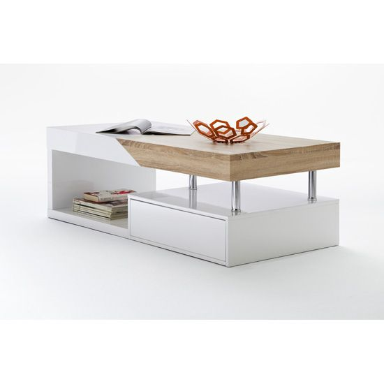 Features• Modern coffee table in white with Oak sawyer , bring a touch rustic elegance into your home• Bright elegant feel • Featuring a funky design, Chromed support for extra ...