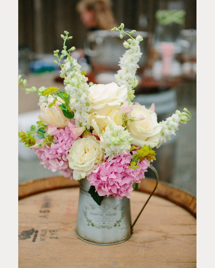 Looking for unique centerpieces for your rustic wedding that do not include Mason jars? So are we! We love Mason jars but are ready to move on! Check out these gorgeous blooms which are right at home in any barn, backyard or casual outdoor affair. Lead photograph ~ Volatile Photography; Vanda Floral Watering Cans, Tea Pots and Pails …