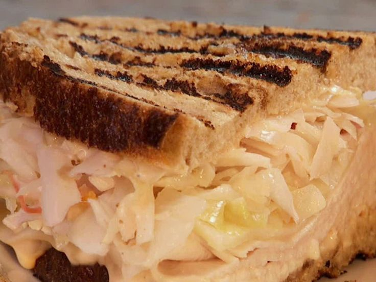 "Yes, please! ""Get this all-star, easy-to-follow Grilled Turkey Reuben recipe from Paula Deen"""