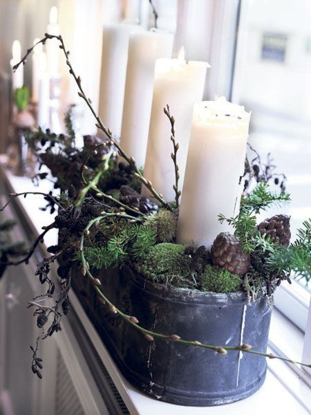 decorating with Christmas greens - rustic tin trough/bucket with sprigs, pinecones, & candles