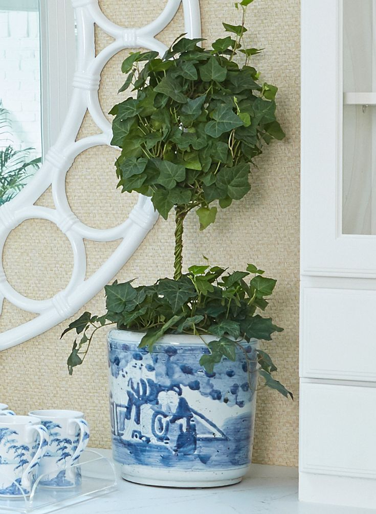 Stroheim's Pasir Paperweave wallcovering in Hay behind Basset Mirror Company's Noria Wall Mirror.