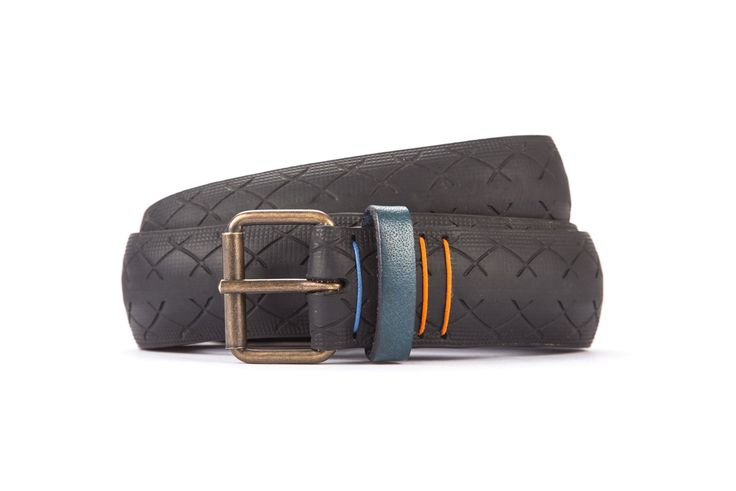 #2908 - Black belt from a spare race bicycle tyre, entirely handcrafted, iron branded and numbered. Dark blue, leather belt loop. Strap folded up and stitched up with cotton colored strings.