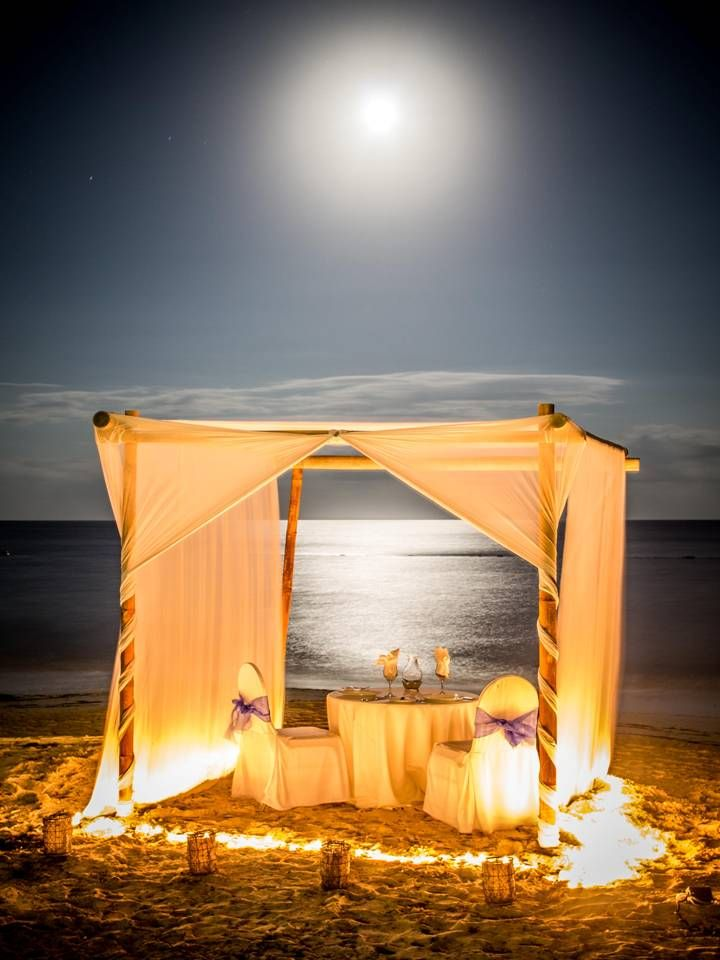 Romantic dinner set up on the beach.