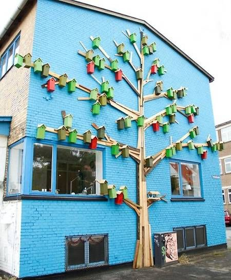 Happy City Birds birdhouses on blue house Love the ideas in this site..