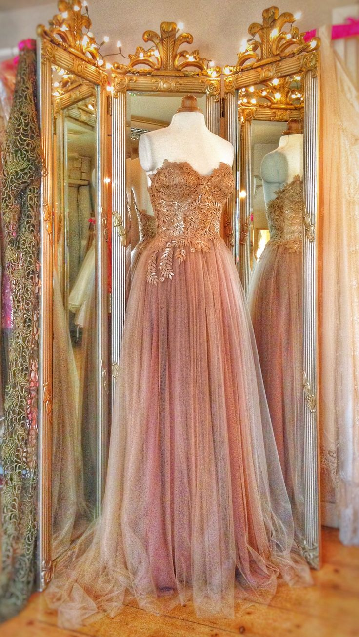 Gilded lace bodice with nude and mocha tulle and silk chiffon skirt. A gold wedding dress by Joanne Fleming Design