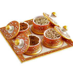 Square Marble Tray with dry fruit Bring an artisan essence to your home with this rich and ethnic look marble tableware. The tableware comes with a square white marble tray that has been hand painted in bright orange and gold with accents of white and lined with pale gold borders. .It consists of 4 containers which contains cashew, almond, raisins and roasted pista . Costs Rs 2165/- http://www.tajonline.com/diwali-gifts/product/d4177/square-marble-tray-with-dry-fruit/?aff=pinterest2013/