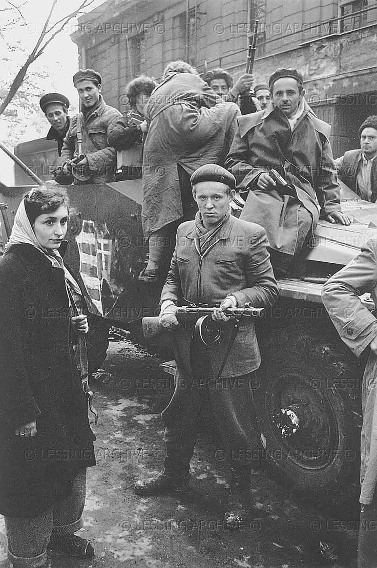 Freedom fighters on an armoured vehicle.