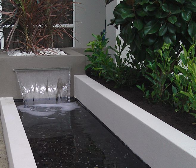 Customised Water Blade Feature Into Contemporary Pond