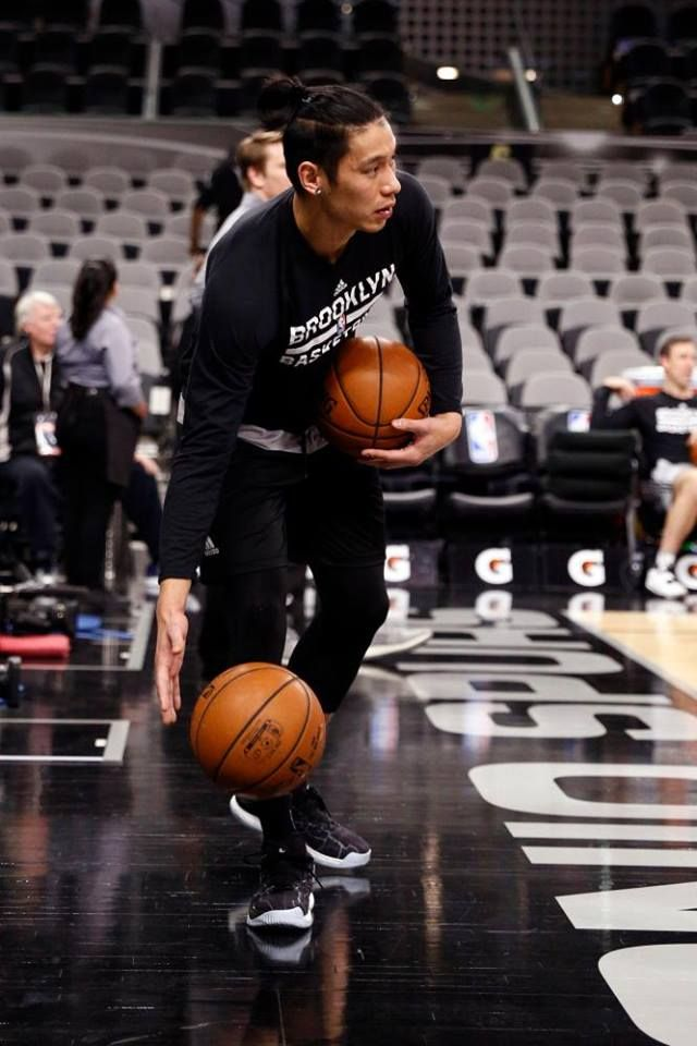 Dec 10, 2016; San Antonio, TX, USA; Brooklyn Nets point guard Jeremy Lin (7) gathers up the basketballs prior to the game against the San Antonio Spurs at AT&T Center. Mandatory Credit: Soobum Im-USA TODAY Sports