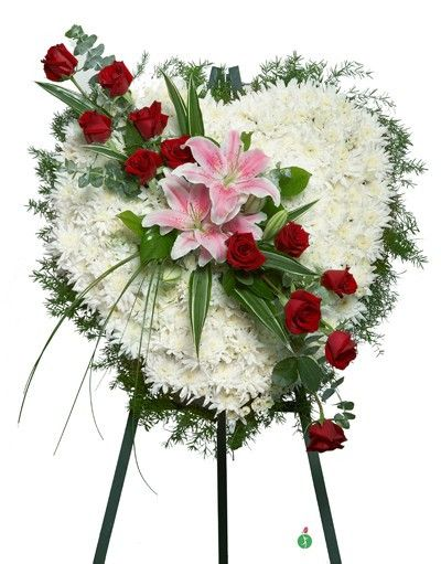 Show that your heart is with them. Send a gift of hope, beauty and devotion. This lovely standing spray of white blossoms in the shape of a heart is adorned with pink lilies and a dozen fresh red rose
