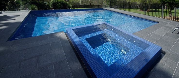 Dark Blue Pool Water love dark paving around a deep blue pool | swimming pools