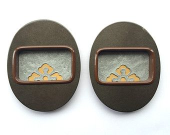 These are great vintage Japanese door pulls!! In Japan, sliding doors are very common and these are used in the sliding doors. **************** These are vintage and each set will have some small difference in terms of wear and tear etc.      They are from the 昭和 showa period . The showa period is from 1926-1989.    These would be fabulous as frames for your art, a small dish for teeny tiny objects etc.    They measure 7.5 x 6 cm .The hole measures about 4.5 x 2.6 cm. You get 2 in this set…