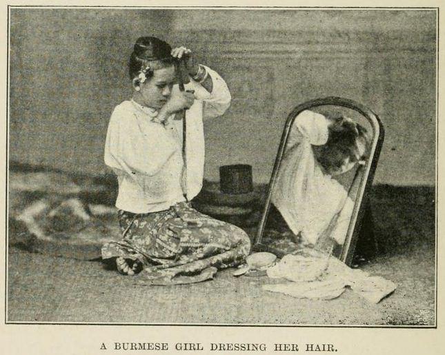 A Burmese Girl Dressing Her Hair
