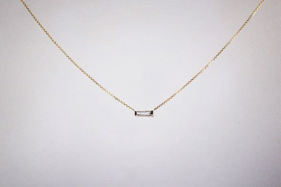 A larger version of my tapered baguette necklace, a .10 carat, GSI+, tapered baguette, set in a 14k gold setting, soldered in the center or off-centered