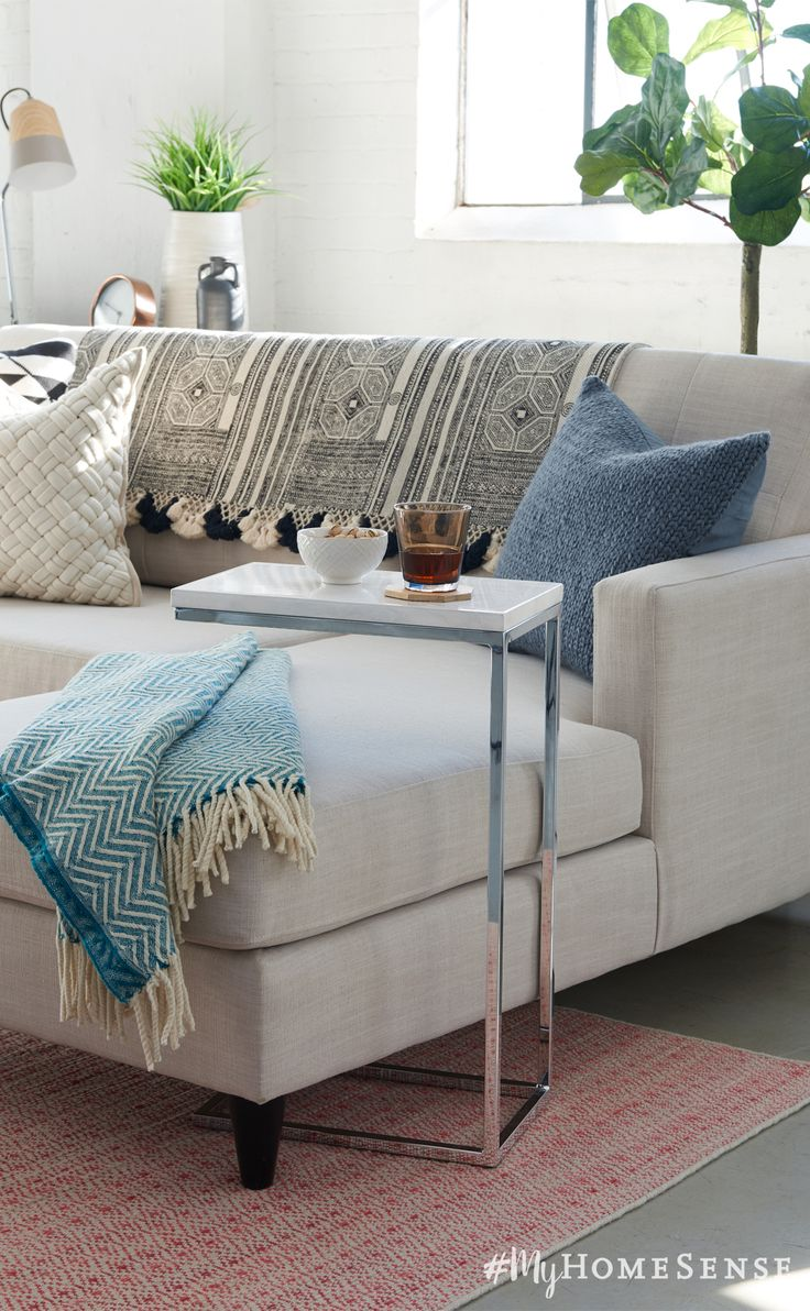 Décor ABC's: C tables fit perfectly over an L sofa. Small accent tables are made for small space living, offering all the convenience without the bulk.