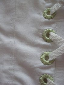 Stitching around a grommet for a decorative detail.