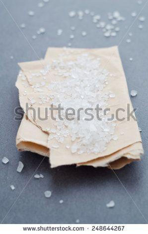 Closeup of salt over brown baking paper