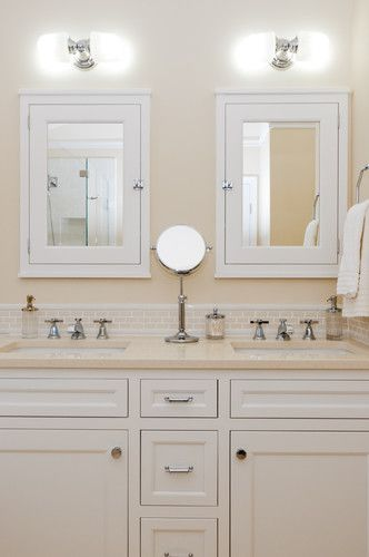 Traditional cream and white bathroom - Sconces from Hudson Valley Lighting Burlington collection 222 (by Collins Tile and Stone)