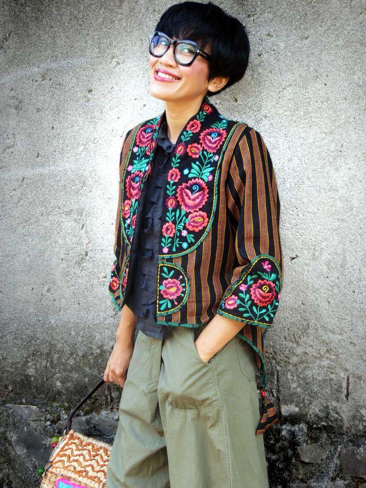 Batik Amarillis's creative director Selly Hasbullah wearing Batik Amarillis's Arcana jacket#3 in Lurik surjan of yogjakarta , Indonesia features Hungarian embroidery and blogger wrap pants also Tom Ford glasses.
