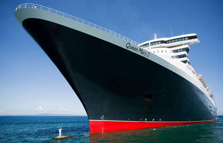 Cunard recently captured dramatic photographs of Captain Kevin Oprey, Master of Queen Mary 2, standing on the ship's bulbous bow a mile off the coast of Bali during the ship's World Cruise in her 10th anniversary year.