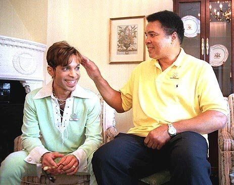 Prince getting petted by Muhammed Ali.