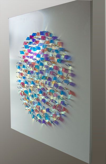 Chris Wood, Chroma Other Circular arrangement of Dichroic Glass interacts with light to create patterns of coloured light which change depending upon viewpoint and angle of light.