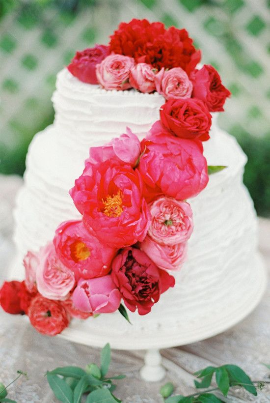 red flower topped wedding cake