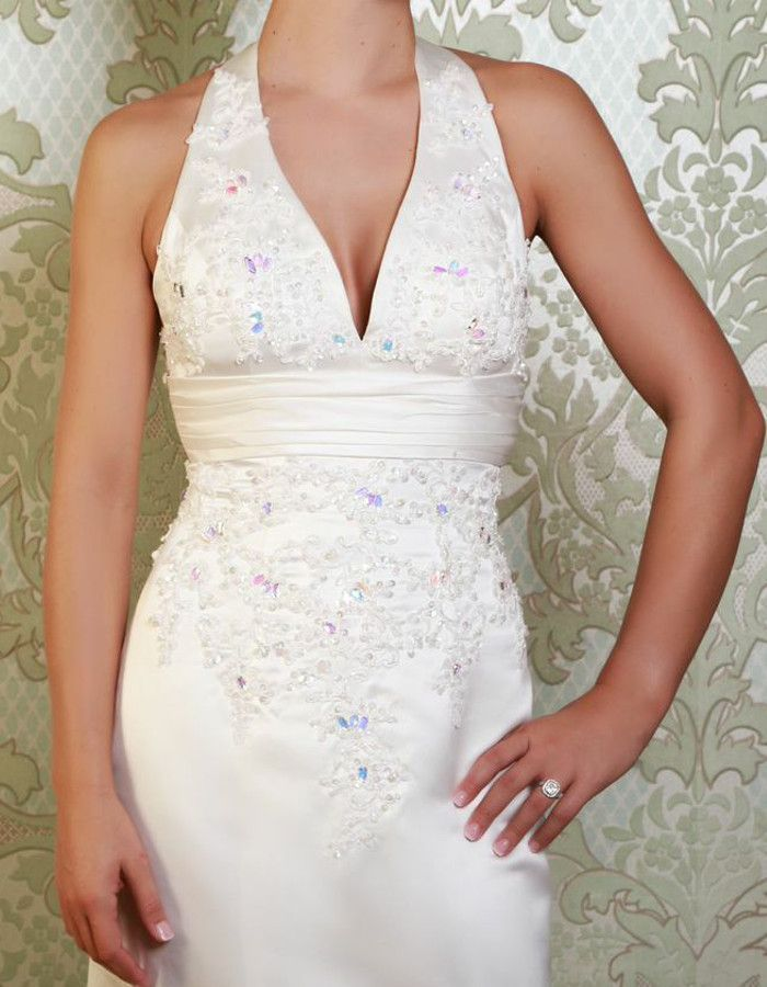 STANWYCK The glamorous halterneck style of this fitted fishtail gown creates a perfect 1950's feel to this gown. Embellishments include lace applique detail and eye-catching beading. https://www.wed2b.co.uk/vintage-wedding-dresses/viva-bride-stanwyck.php