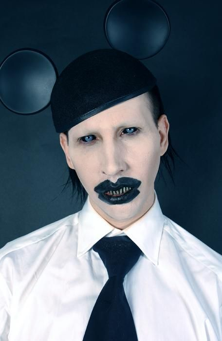 Another pic of Marylin Manson with Mickey Mouse ears = mind control