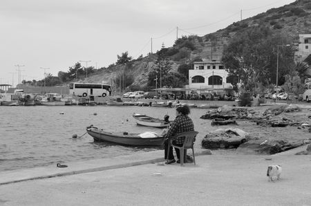 Fisherman in Mesta harbor. Photo by feray umut — National Geographic Your Shot
