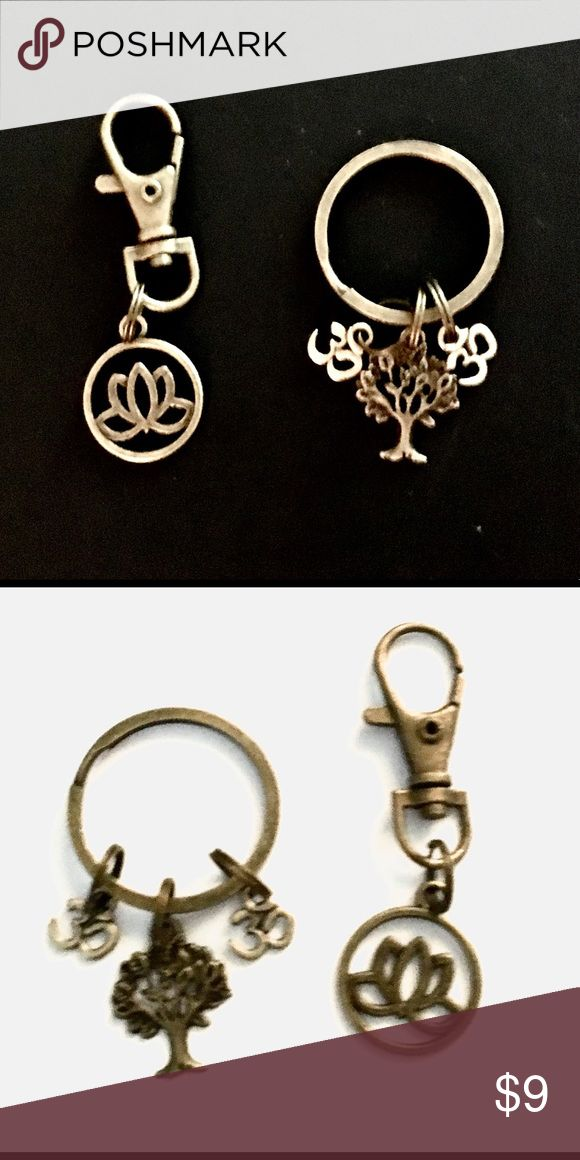 Lotus Key chain and Bag Clip Set Key ring charms include: Tree of Life, OM Symbol and Lotus Flower. All bronze in color. Bag clip also features a beautiful lotus flower! Beautiful set! Accessories Key & Card Holders