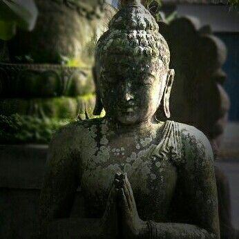 Black stone Buddha statue at Kuluk Gallery, Ubud, Bali