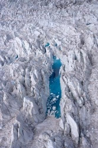 Aerial view of a blue lake in Fox Glacier, Westland National Park, South Island, New Zealand