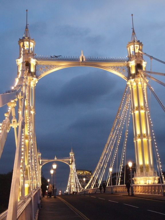 """Albert Bridge, which spans London's Thames between old Chelsea and Battersea, is about as twinkly as a bridge can be."