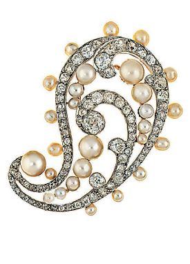 An early 20th century diamond and pearl brooch. Of openwork single paisley pattern design set throughout with old brilliant and old-cut diamonds, with pearl accents, mounted in gold and platinum, circa 1910.