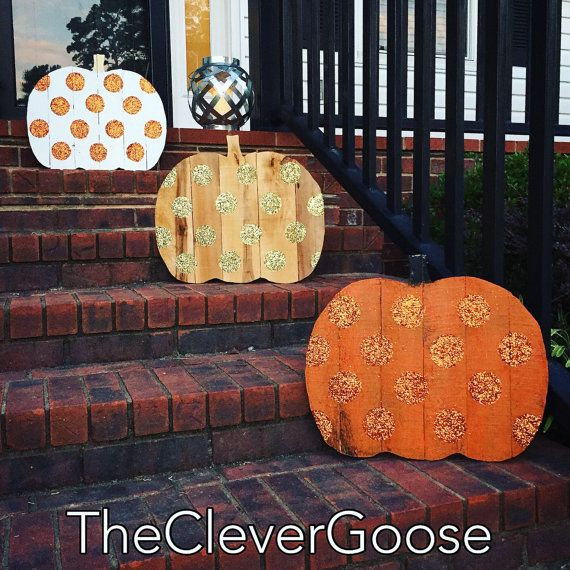 Needing a little whimsy in your life??? This pumpkin is for you, where rustic meets glam! Handcrafted and cut from reclaimed wood. Gold glitter dots were applied and sealed for minimal shedding. Use anywhere in your home, mantle, or on your door. Perfect for Fall, Thanksgiving or Halloween. Approx. 19.5 wide and 16 tall. Wood color may vary slightly as pumpkins are crafted from reclaimed wood. Follow us on Instagram @theclevergoose Or on fb at www.facebook.com/CleverGoose