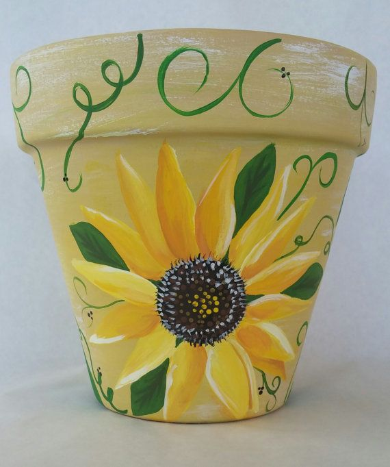 Hand painted flower pot with bright and cheery sunflowers. Brighten up any indoor or outdoor living space with this beautiful hand painted clay pot. I have used a slight different approach when painting this pot. I used a dry brush technique on the base color so there is a bit more dimension and a slight worn look. This is a bigger flower pot than others listed in my shop. Measures 8×8 Acrylic paint and poly sealed