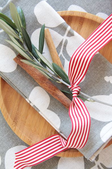 Create the perfect Christmas table with natural elements. Cinnamon sticks and a stem from your olive branch bush make a great table decoration.  www.dandi.com.au
