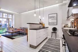 Znalezione obrazy dla zapytania salon z aneksem kuchennym białą cegła