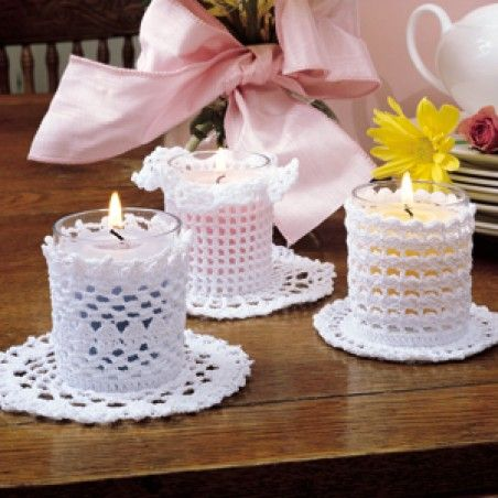 "This trio of illuminating candle sleeves will help you step out from the decorating shadows. To beautify a room with candlelight and lace, choose from Picot Clusters, Mesh Ruffles, or Clusters patterns and pair them with fragrant votives in glass holders. Our designs are crocheted using bedspread weight cotton thread (size 10) and a size 7 (1.65 mm) steel crochet hook. Number of Designs: 3 candle sleeves Approximate Design Size: 2-1/4"" tall to fit a votive candle holder"