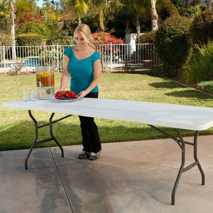 80277   Lifetime Eight Foot Fold In Half Table Next To Grass